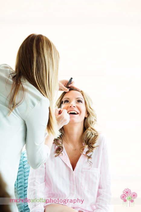 bride having makeup applied w hotel downtown