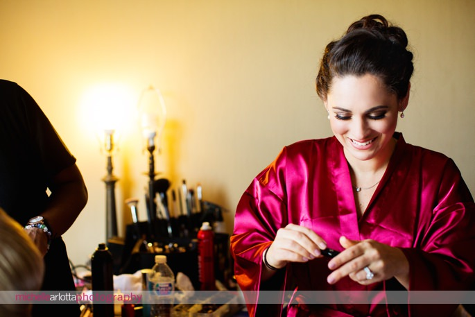 bridesmaid in red robe during prep