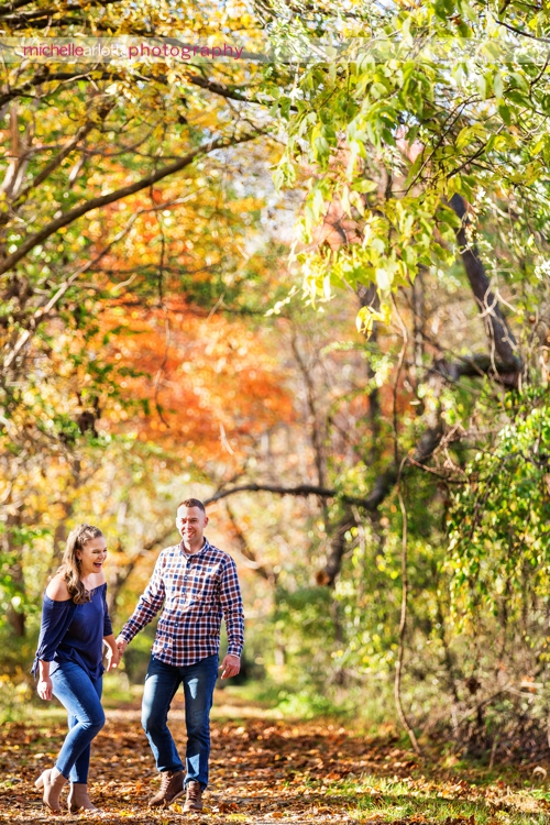 bear brook valley couple fall engagement session in Frenchtown New Jersey laughing together