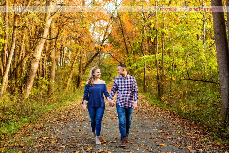 bear brook valley couple holding hands and walking during fall engagement session in Frenchtown New Jersey michelle Arlotta photography