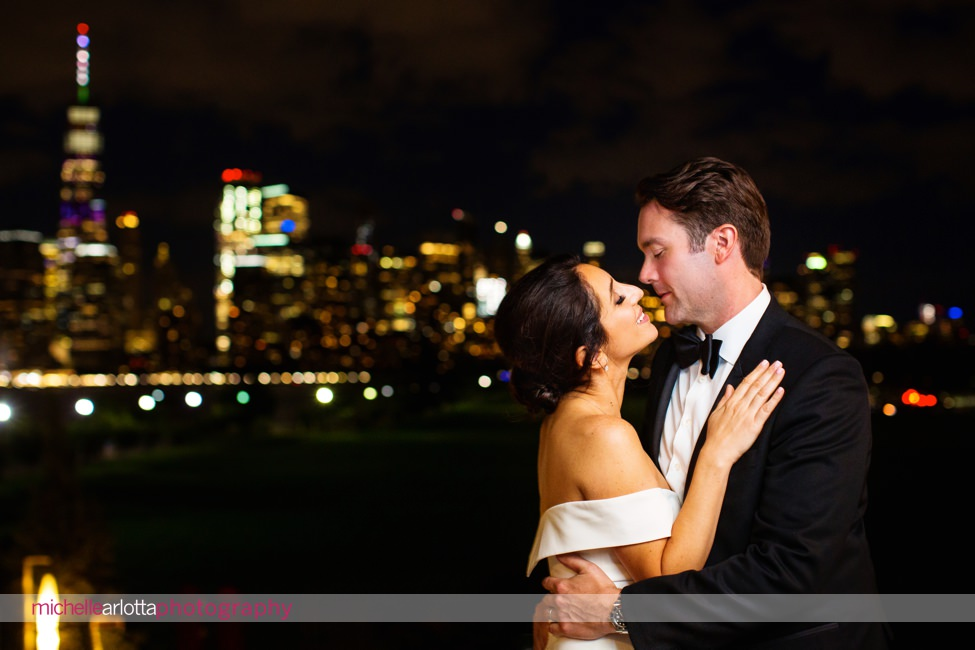 landmark venues Liberty House summer wedding new jersey reception nighttime couple portrait with nyc skyline