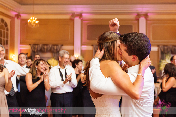 Bride And Groom Kissing During Last Song Groom Holding Fist Up High
